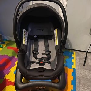 Car seat with base and white cover